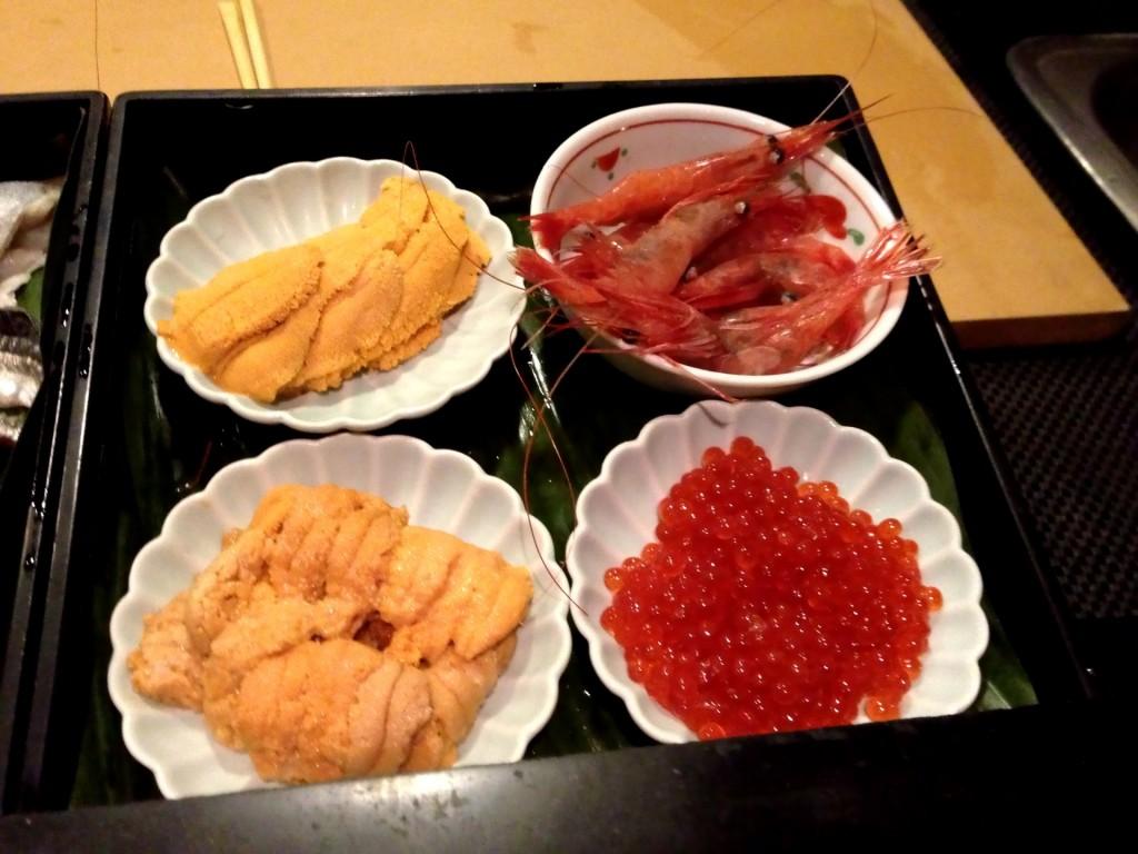 Clockwise from Bottom Left:  Maine Uni (Sea Urchin), Santa Barbara Uni, Amaebi (Sweet Shrimp), and Ikura (Salmon Roe) @ Sushi Taro (© 2013 The Offalo)