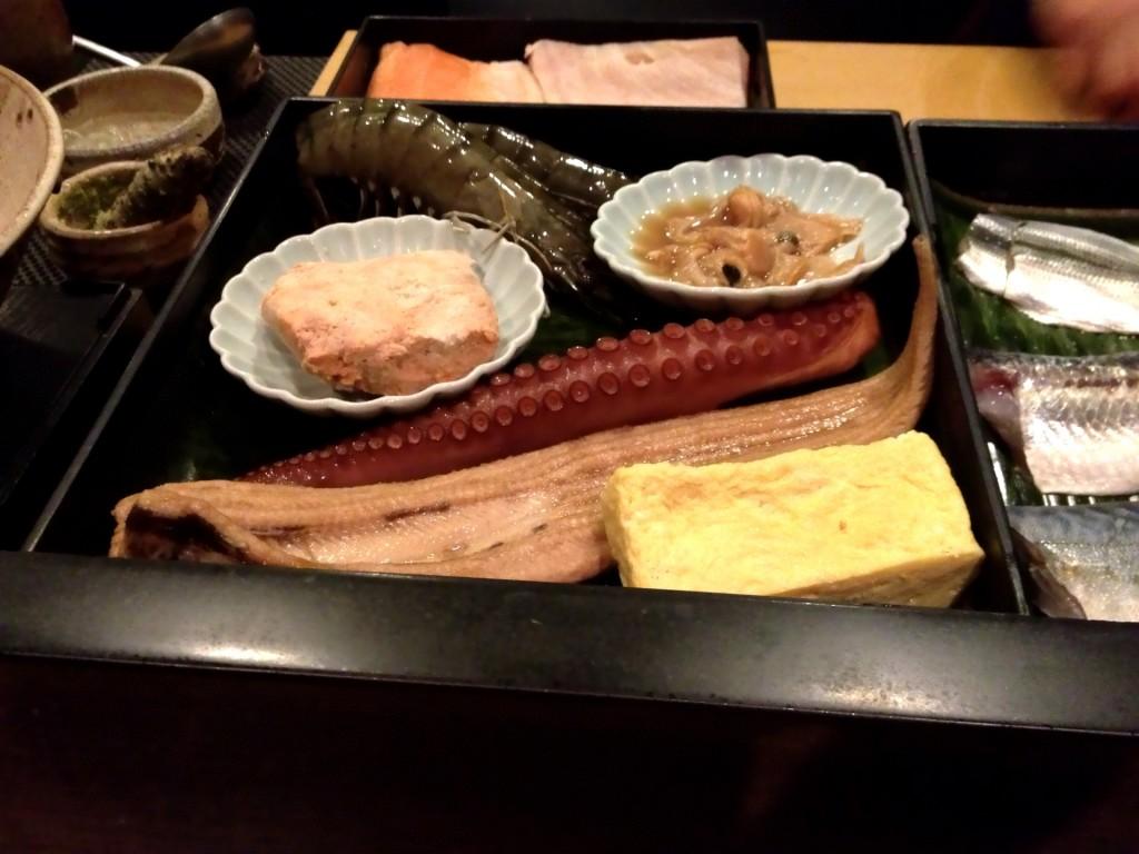 Top to Bottom:  Kuruma Ebi (Wheel Shrimp), Hamaguri (Common Orient Clam), Ankimo (Monkfish Liver), Tako (Octopus), Anago (Sea Eel), Tamagoyaki (Grilled Egg) @ Sushi Taro (© 2013 The Offalo)